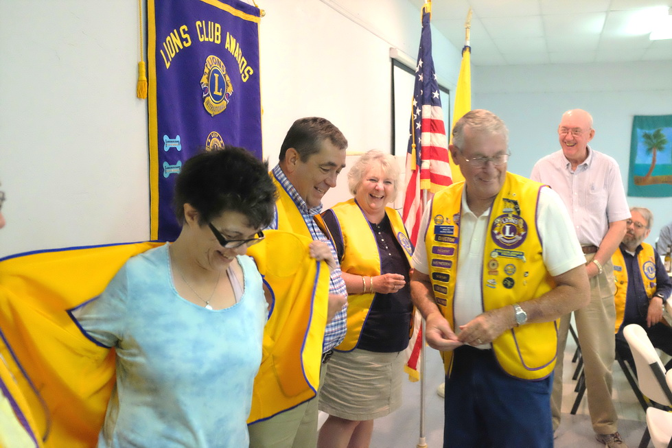 MAR 29 A- New Lions Leslie Valens and Steve and Diana Priessman receive their Lions vests. 1